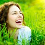 woman smiling in grassy field