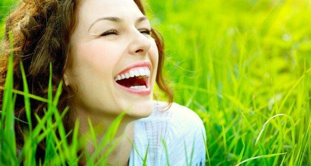 woman smiling in grassy field