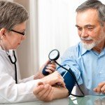 man with blood pressure cuff