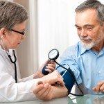 man with blood pressure cuff
