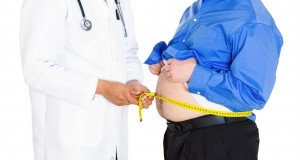 doctor with obese man