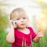 toddler with cell phone
