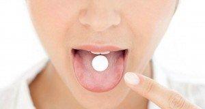 woman-taking-pill